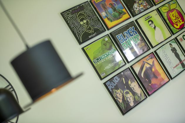 Wall display of framed records